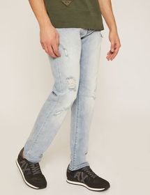 SLIM-FIT LIGHT INDIGO JEAN WITH DISTRESSING