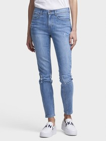 THE SOHO SKINNY JEAN—STUDDED & PATCHED
