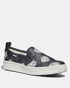 Coach c115 with signature floral print
