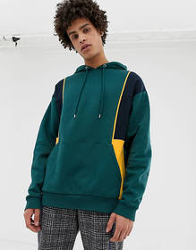 ASOS DESIGN oversized hoodie in green with color b