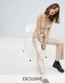 One Above Another flares in sequin two-piece