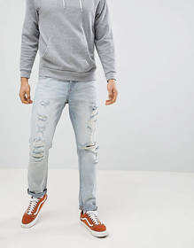 ASOS DESIGN slim jeans in light wash blue with hea