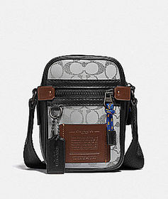 Coach dylan 10 in reflective signature canvas