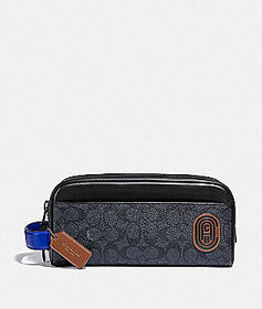 Coach travel kit in signature canvas with coach pa